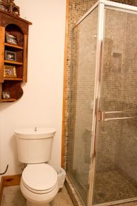 Toilet/shower area basement bathroom