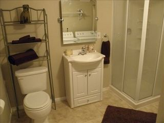 Manitou Springs townhome photo - Basement bathroom with walk-in shower and washer/dryer combo.