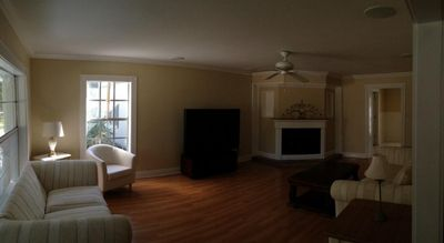 living rm with 66' diagonal screen surround sound cinema & working fireplace