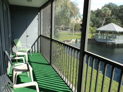 Screened lanai with with lake view.