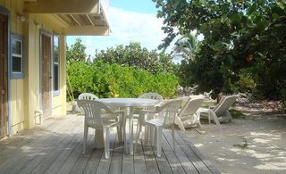 Cayman Brac house photo - downstairs guest lounging area under the trees