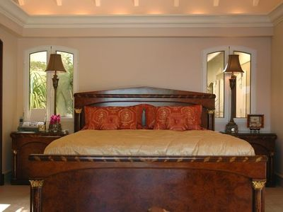 A first large master bedroom with king size bed , TV and ensuite bathroom