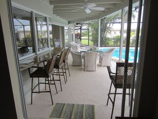Vacation Homes in Marco Island house photo - Outdoor bar seating and table
