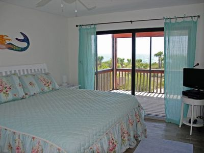 King Suite has private bath, TV, and seaside screen porch entrance.