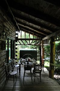 Enjoy meals in the shade of the front porch just off the kitchen