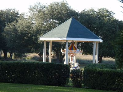 Clermont estate rental - carousel horse in front of main house..