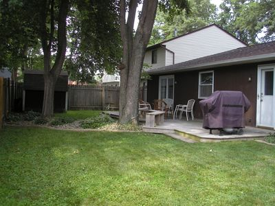 backyard with deck, gardens and grill