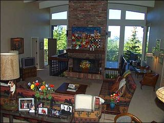 Snowmass Village house photo - Large living room with brick fireplace and views!