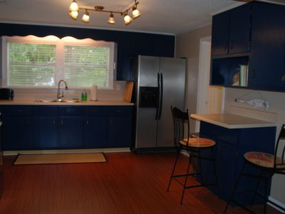 Stainless appliances, double sink, breakfast bar