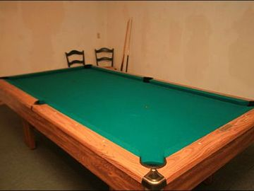 Game Room Includes a Pool Table