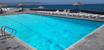 The olympic sized swimming pool is right on the ocean and steps from our house