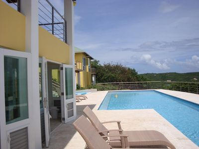 Pool area: kitchen, full bathoom, outdoor shower, sun bathing area