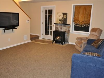 Lower level den with flat screen TV, DVD, and gas fireplace.