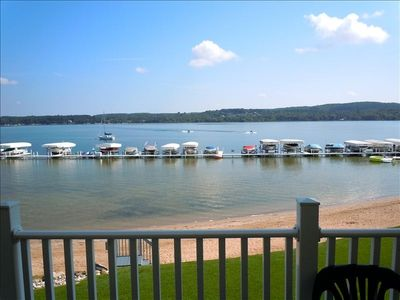 East Jordan condo rental - View from balcony - looking east. Boats and dock are part of complex