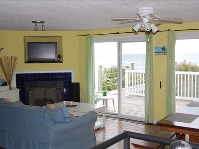 The living room has TV, fireplace, and a wonderful view of the beach.