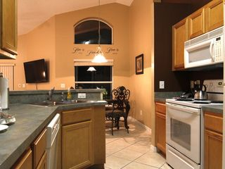 Emerald Island villa photo - Fully equipped kitchen with bar and breakfast nook overlooking the pool.