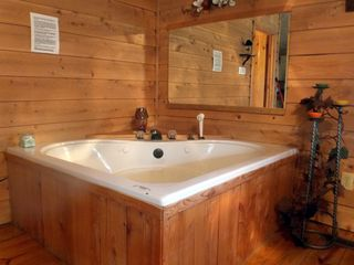jacuzzi for two - romantic cabin near Crossville and Cookeville, TN - Muddy Pond cabin vacation rental photo