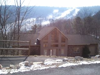 Massanutten house photo - Front view of the Ski Slope Lodge with the Slopes behind them.