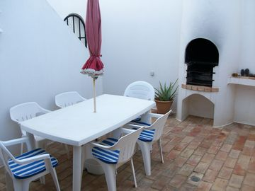 Dining patio, BBQ area and access to roof terrace