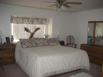 King sized master bedroom - sun rises on other side of house.