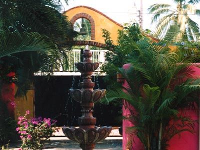 LARGE FOUNTAIN IN CENTER OF COURTYARD ENTRY