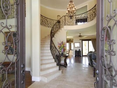 Gorgeous granite entryway greets you with through the 10' iron doors