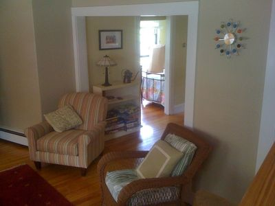 Oak Bluffs house rental - View from staircase into living room, part of dining room, and lower bedroom.