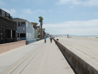 Mission Beach townhome photo - The Ocean boardwalk 50 steps from the property down Whiting Court walkway (left)
