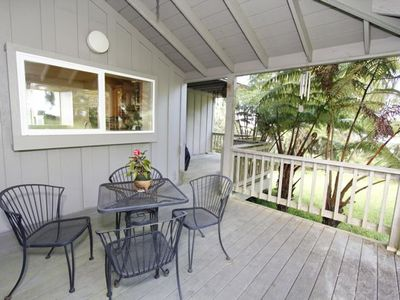 Lanai with BBQ grill and outdoor seating.