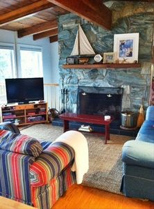 Main level living area - cozy fireplace, new TV, board games & puzzles