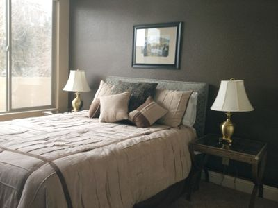 Bedroom has queen bed, large dresser, generous nightstands, & walk-in closet
