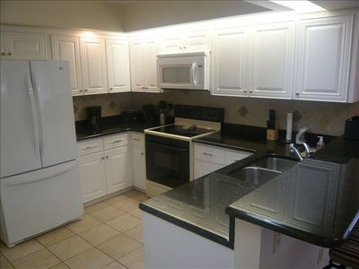 All new granite countertop kitchen, fully equipped with breakfast bar and table.