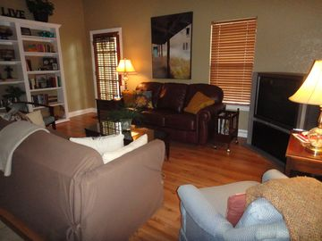 Living Room w/ two full size sofas, large TV, cable/internet, 3 attached patio