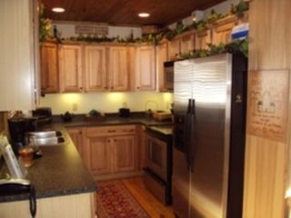 Boone cabin photo - Full service kitchen with stainless steel appliances for homestyle cooking