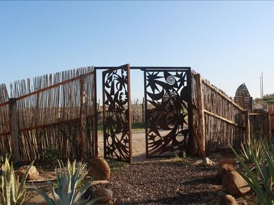 GATE ENTRANCE THROUGH THE CACTUS GARDEN AT TS