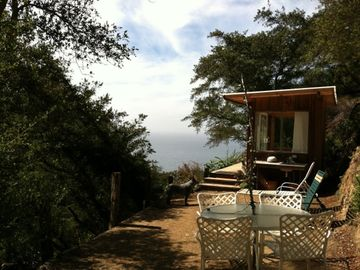 Big Sur cottage rental - View from Trailer looking towards Ocean and Bath house. Nice sunny terrace.
