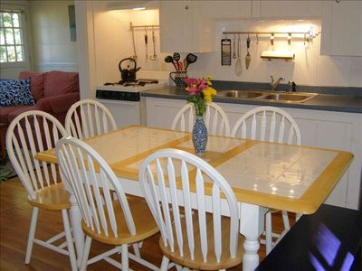 Roomy, dine-in kitchen has table seating for up to seven.