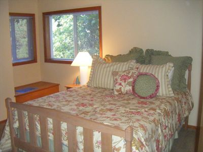 New Queen size bed with comfortable mattress in private bedroom on main level.