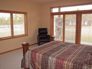 Castle Rock Lake condo photo - Master bedroom with queen bed, TV chair and walkout