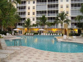 Vanderbilt Beach condo photo - Huge wade-in pool with waterfall and jacuzzi and guest grills