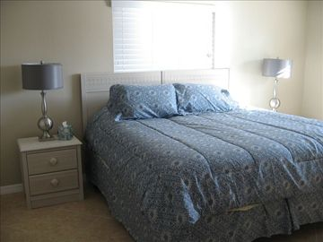 "Master bedroom with king sized bed, 42"" flat panel tv, and private bathroom."