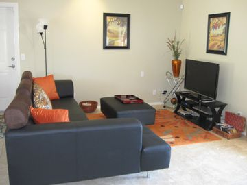 Large leather sectional in great room which looks out to front patio/