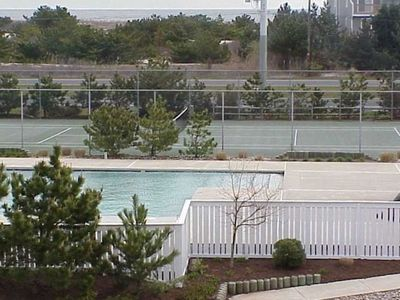 Large community pool, tennis and basketball court, nearby beach
