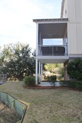 Folly Beach townhome photo - Bottom level and Main level porches - located on river inlet