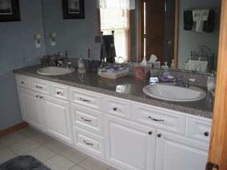 Hampton Bays house photo - Second floor bathroom has double sinks