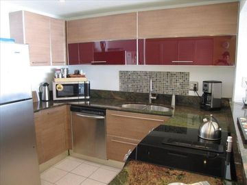 Brand new kitchen with stainless steel appliances and granite counter top