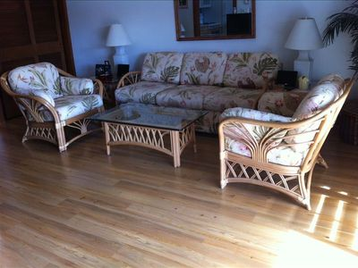 The furniture is bright and comfy; the new wood floors feel amazing!!