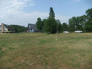 Claybank Township cottage photo - Large yard with tether ball and horseshoes