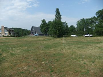 Large yard with tether ball and horseshoes