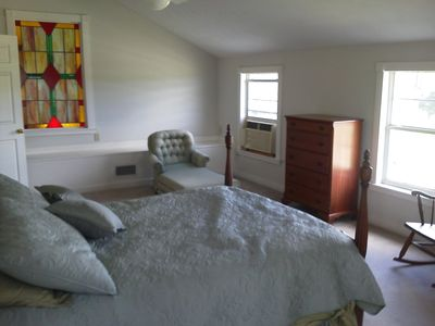 Fourth bedroom with views of the pond and hillside.
